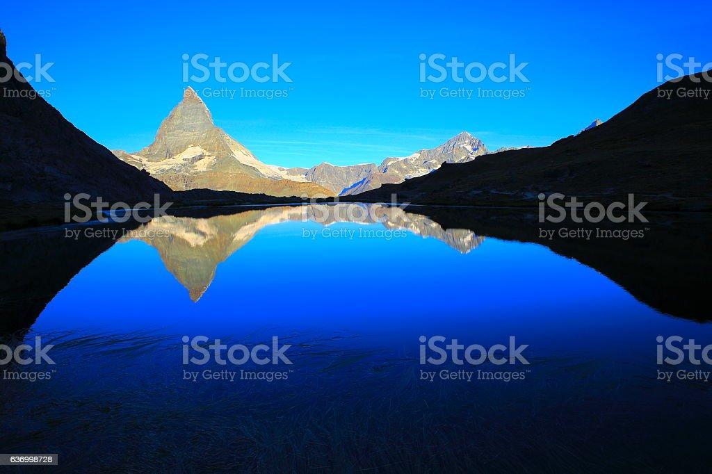 Matterhorn riffelsee lake reflection, swiss alps landscape, Switzerland stock photo