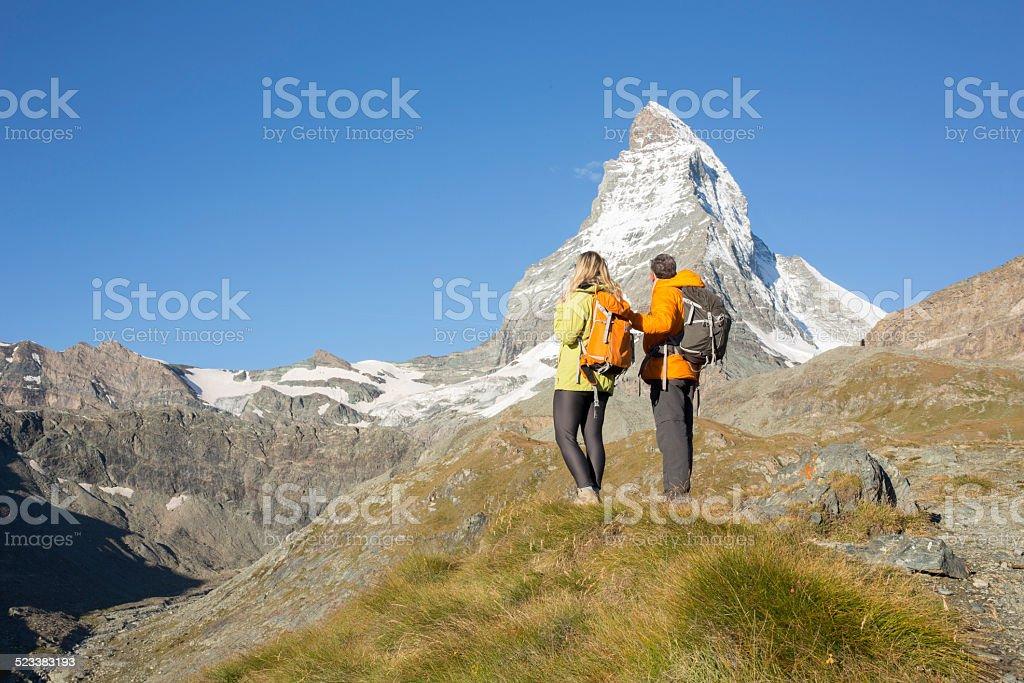 Matterhorn with hikers in meadow below stock photo