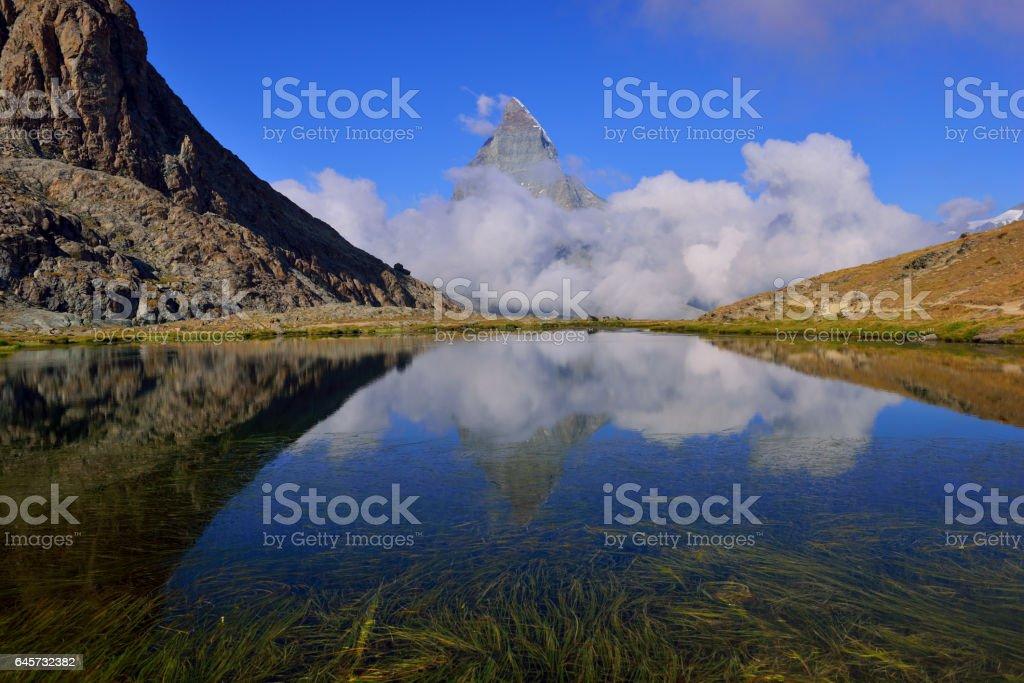 Matterhorn with reflection in Riffelsee, Zermatt, Switzerland stock photo