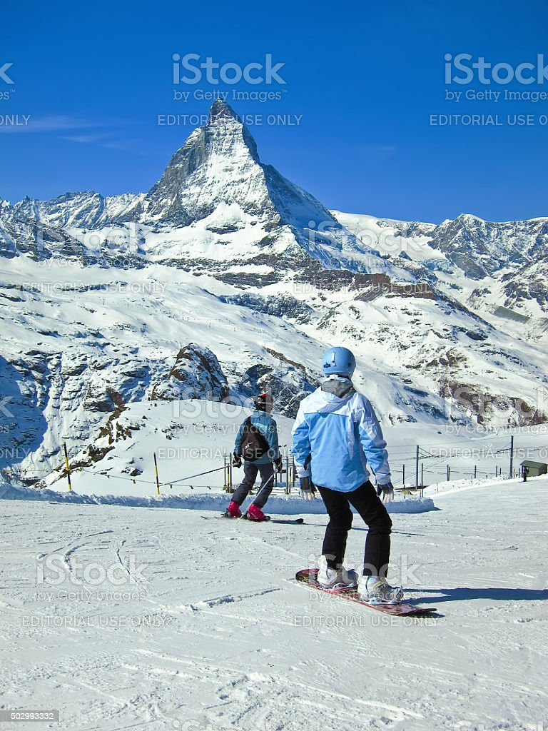 Matterhorn with some skiers skiing from Gornergrat, Switzerland stock photo