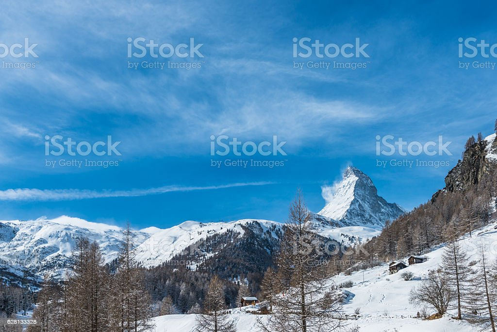 Matterhorn with stable and larches stock photo