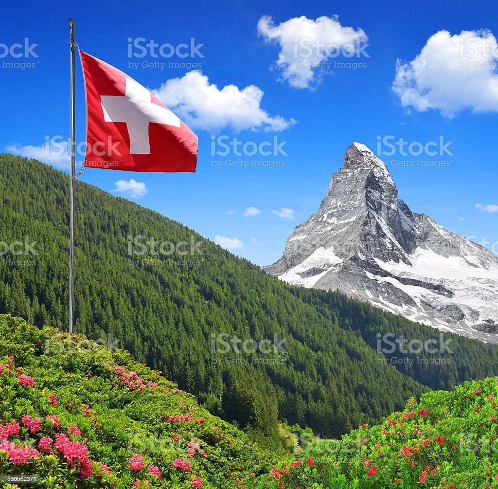 Matterhorn with Swiss flag stock photo