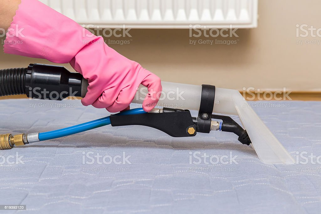 Mattress chemical cleaning with professionally extraction method. Upholstered furniture. stock photo