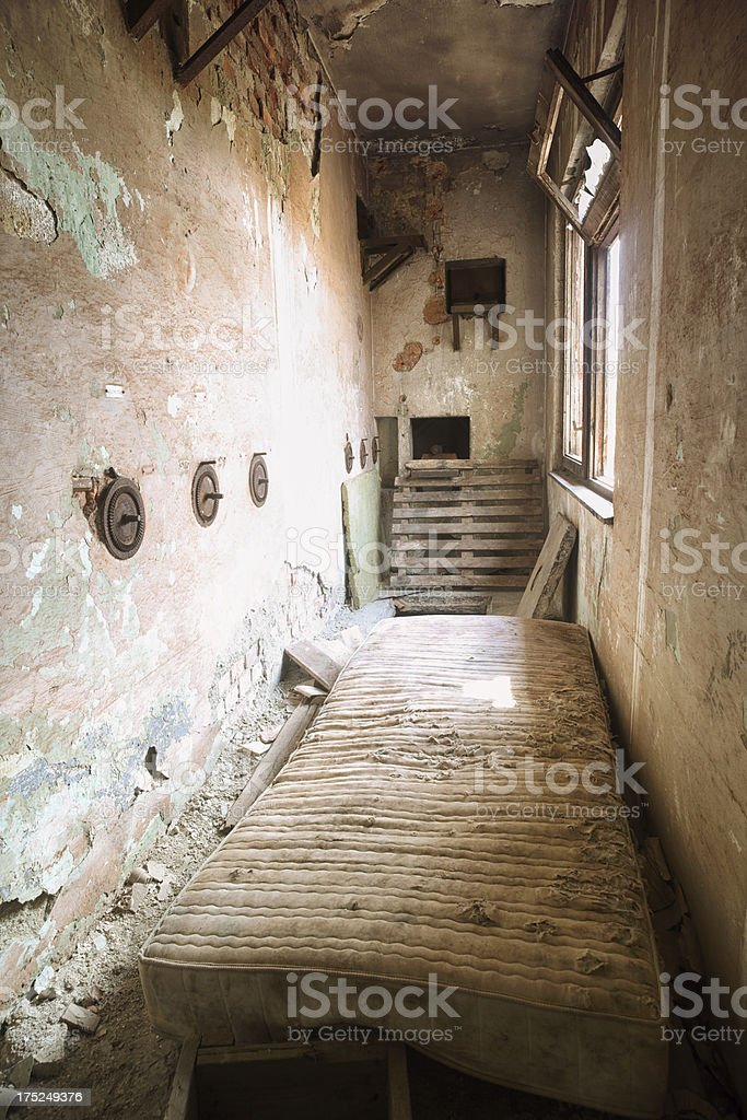 Mattress in deserted old corridor royalty-free stock photo
