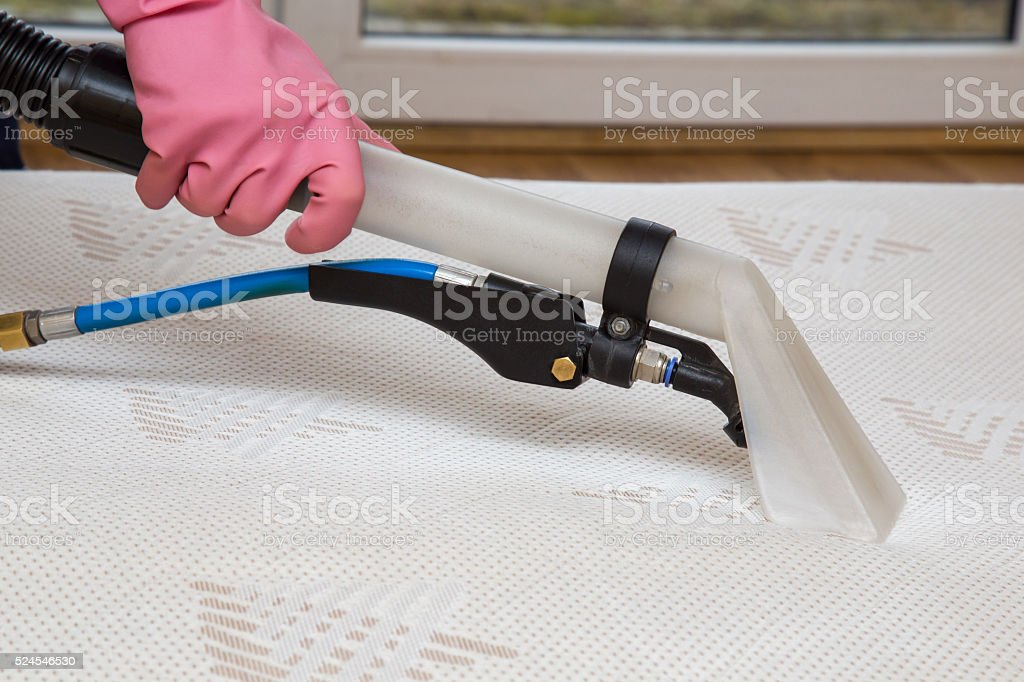 Mattress or bed chemical cleaning with professionally extraction method. stock photo
