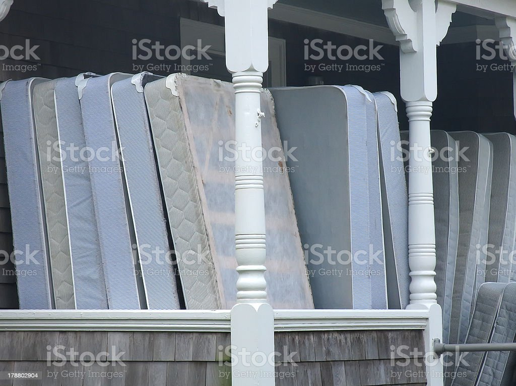 Mattresses on front porch of house royalty-free stock photo