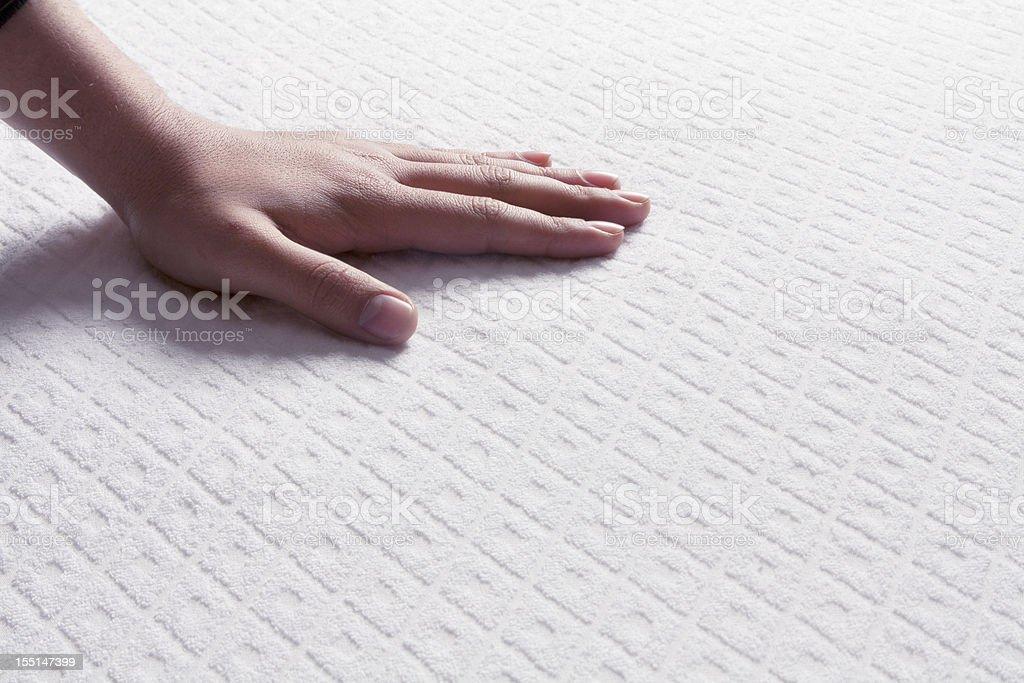 Mattresses on the human hand stock photo