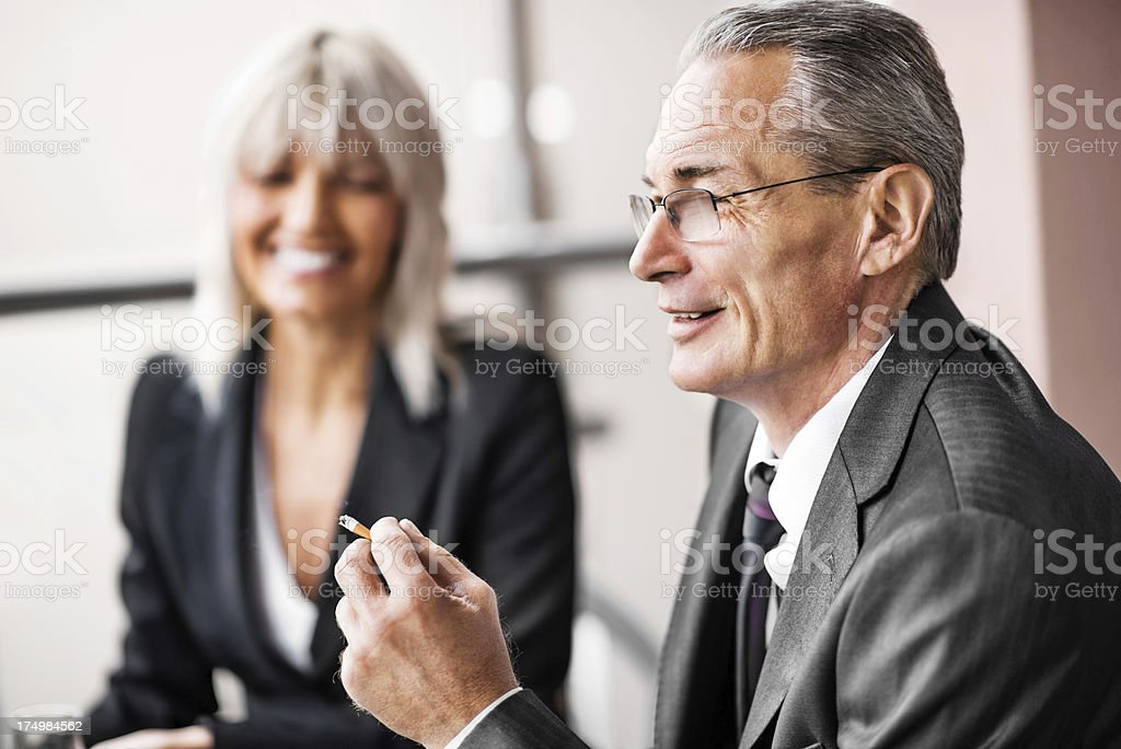 Mature adult businessman smoking a cigarette. royalty-free stock photo