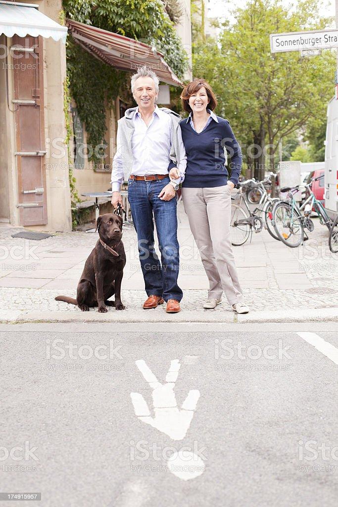Mature Adult Couple walking the dog stock photo