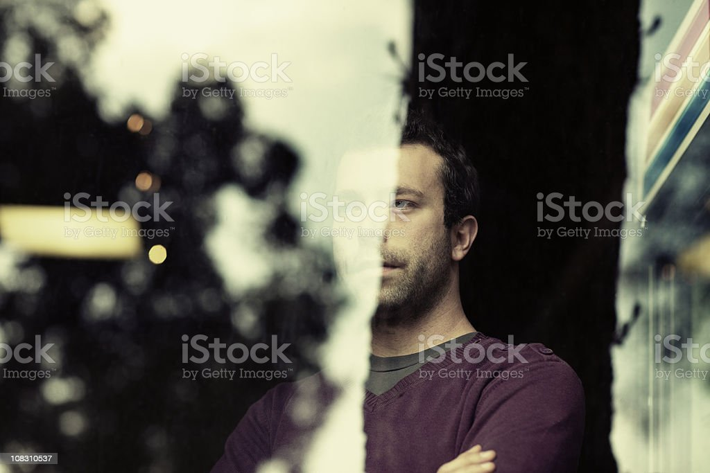 Mature Adult Man behind Glass royalty-free stock photo