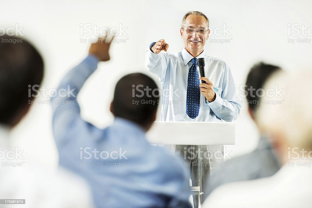 Mature adult man having a public speech. stock photo