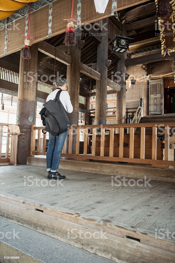 Mature Adult man Japanese men worshiping in the shrine stock photo