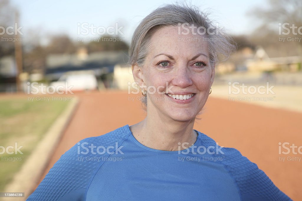Mature Adult Smiling at the Track royalty-free stock photo