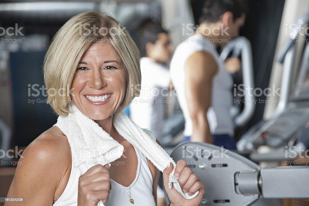 Mature adult with towel after working out at the gym royalty-free stock photo