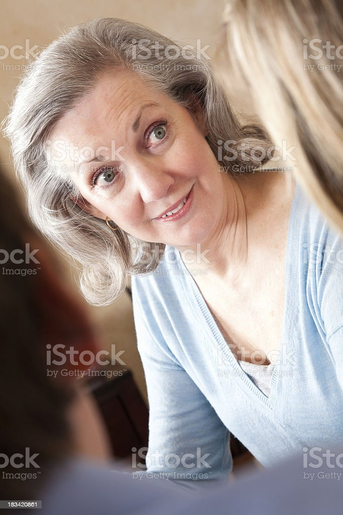 Mature Adult Woman Talking With Younger Couple royalty-free stock photo