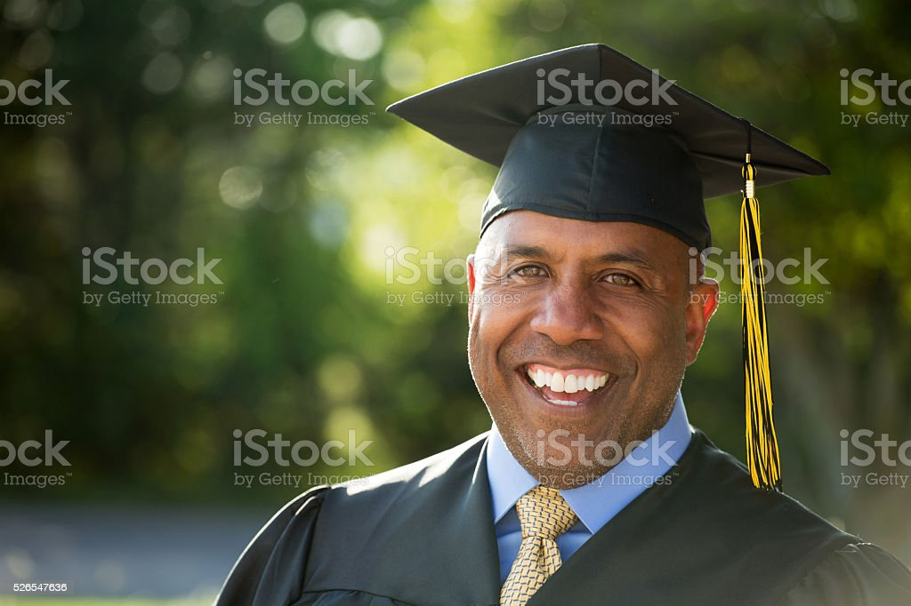 Mature African American man graduating stock photo