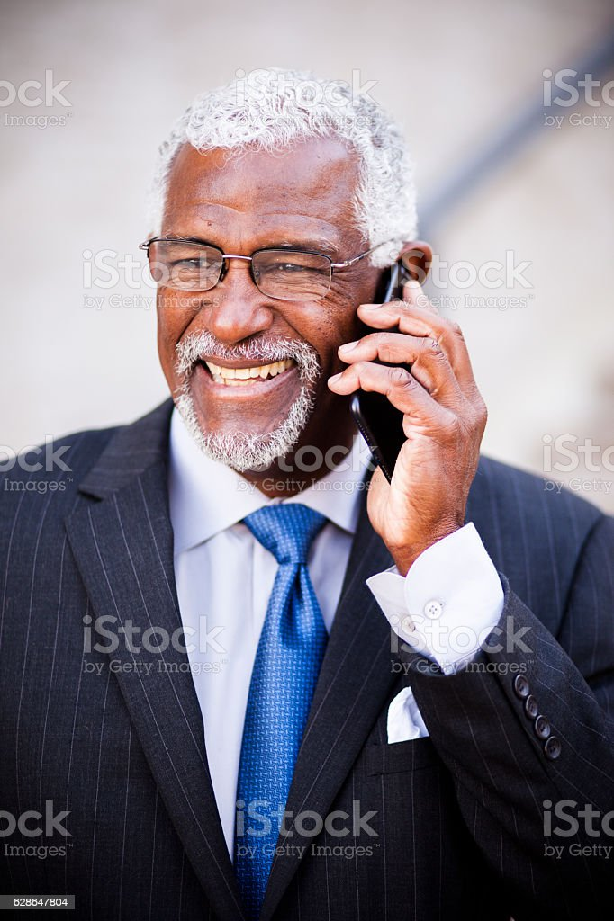 Mature African American Man on Phone stock photo