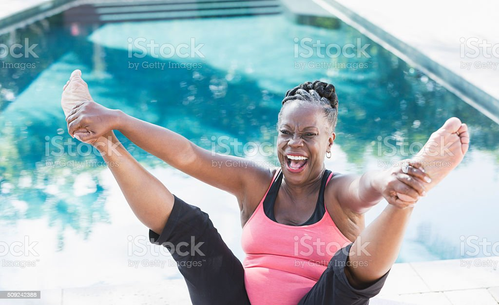 Mature African American woman having fun exercising stock photo