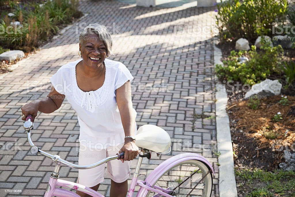 Mature African American woman with bicycle stock photo