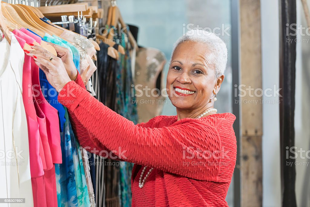 Mature African American woman working in clothng store stock photo