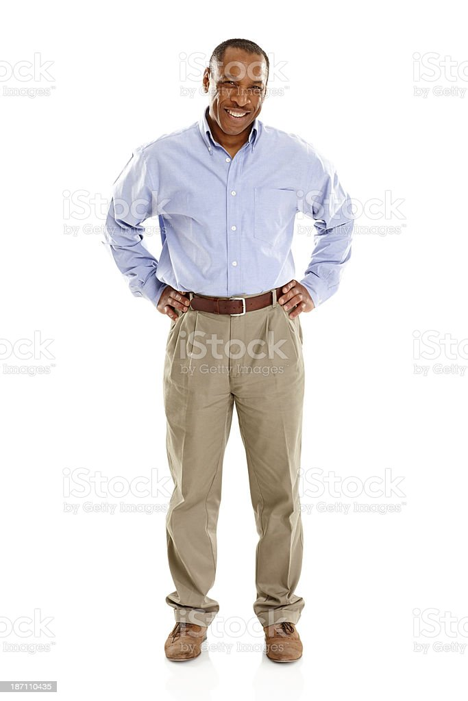 Mature african man standing confidently on white stock photo