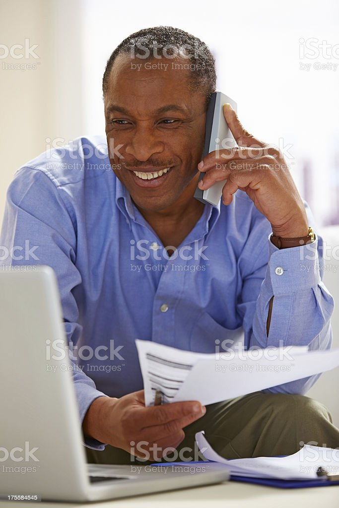 Mature African man working from home royalty-free stock photo