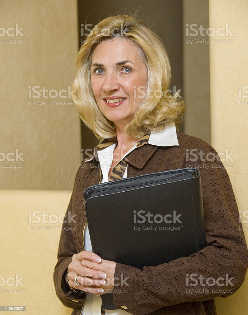 mature and confident business woman royalty-free stock photo