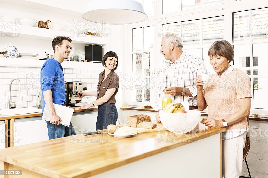 mature and senior couples at kitchen royalty-free stock photo