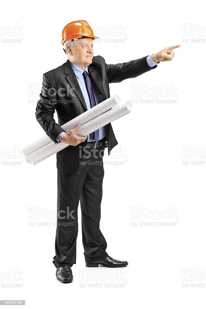Mature architect holding a blueprint and pointing royalty-free stock photo