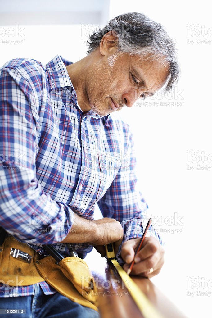 Mature architect measuring with tape royalty-free stock photo