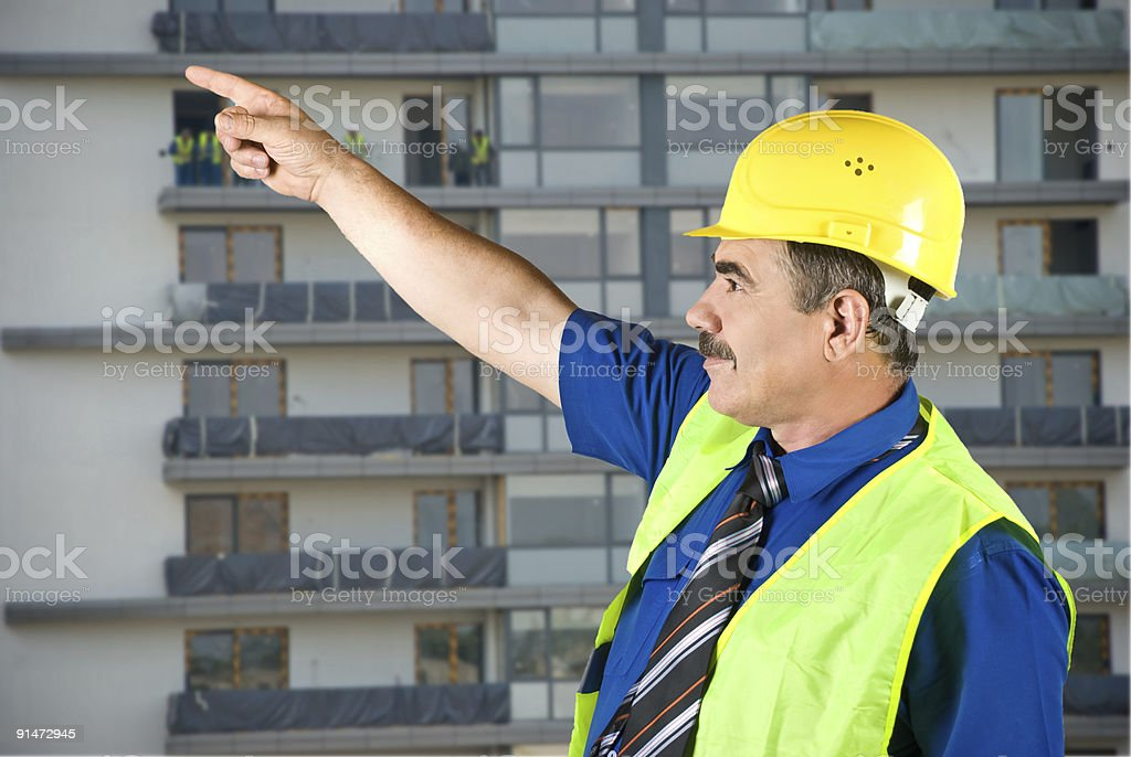 Mature architect pointing on site royalty-free stock photo