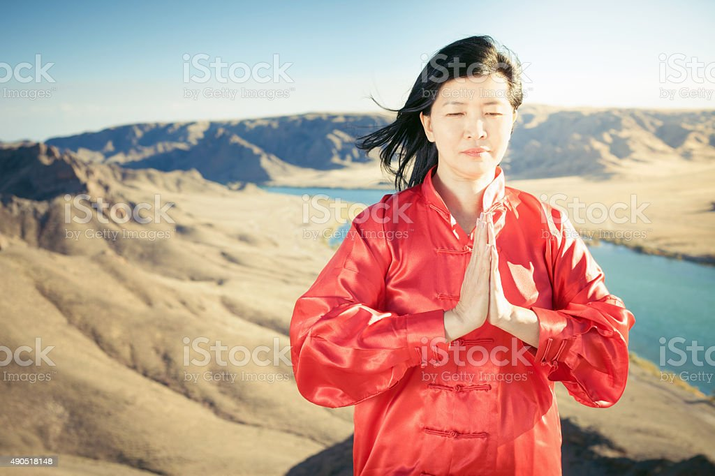 Mature asian woman doing kundalini yoga stock photo