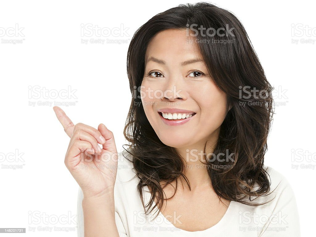Mature asian woman pointing showing royalty-free stock photo
