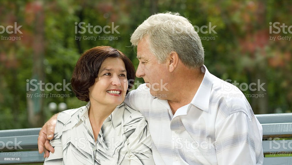 Mature attractive happy couple together in park royalty-free stock photo