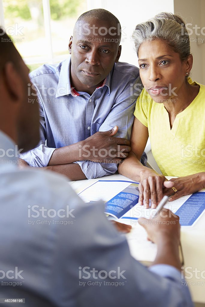 Mature Black Couple Meeting With Financial Advisor At Home stock photo