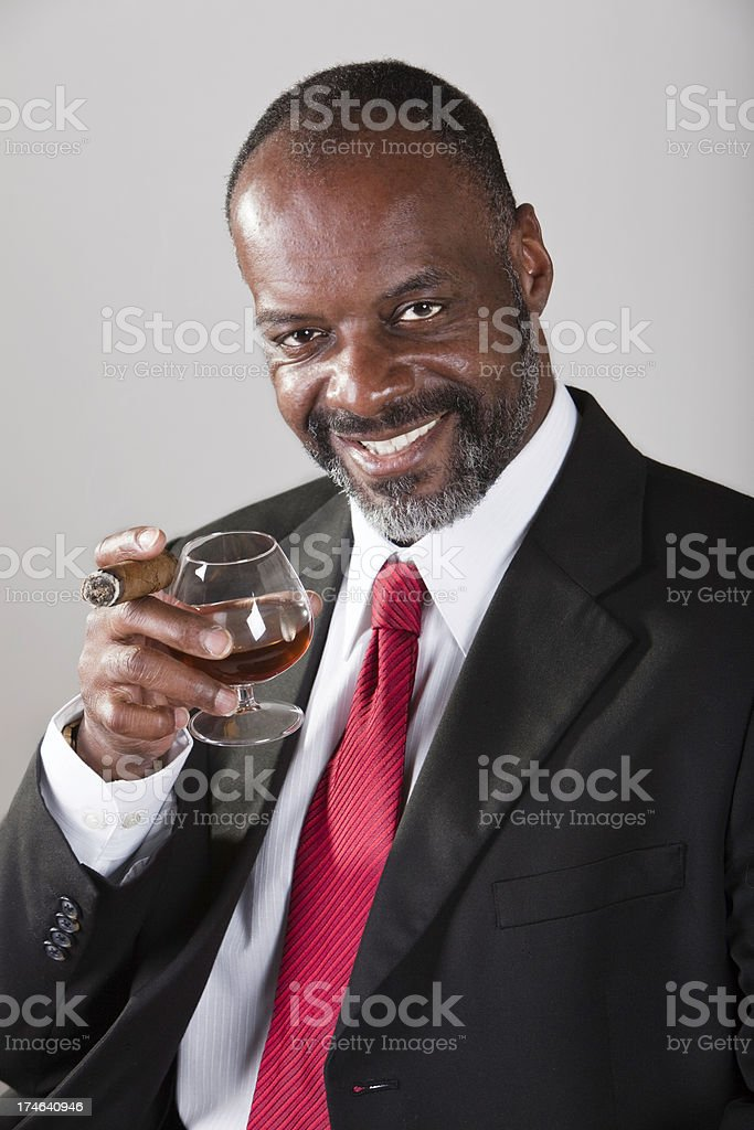 Mature Black Male with Brandy and Cigar royalty-free stock photo