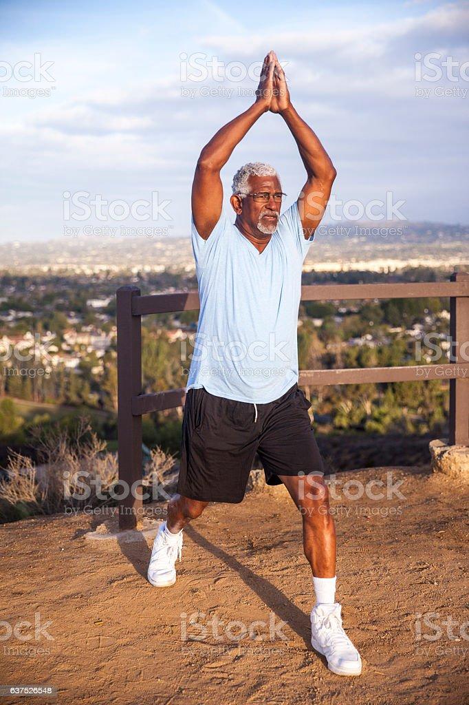 Mature Black Man Exercising Yoga stock photo