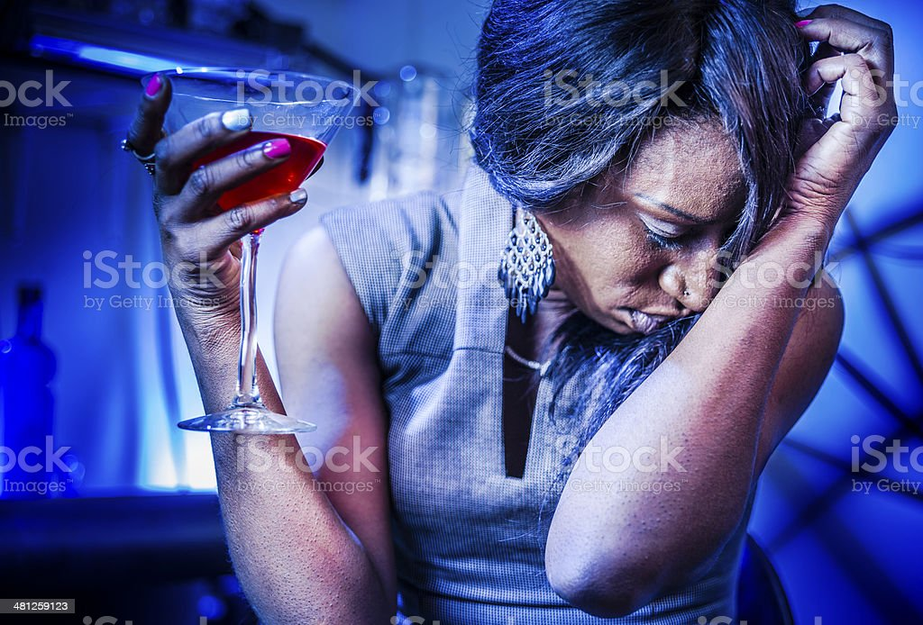 Mature black woman drink coctail royalty-free stock photo