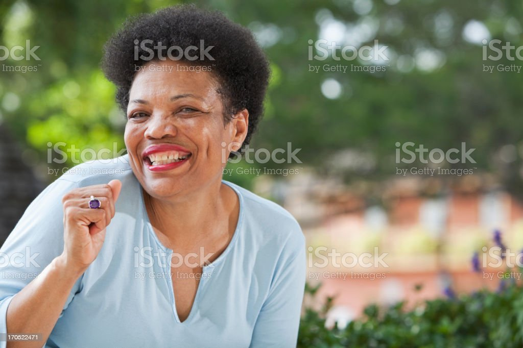 Mature black woman having fun stock photo