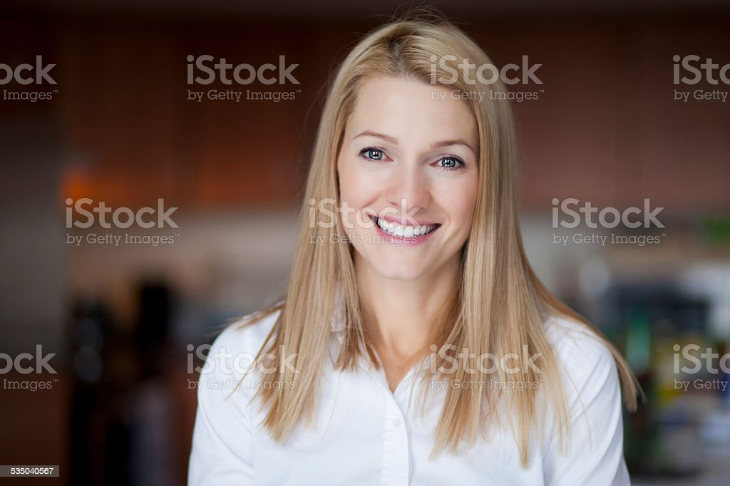 Mature blond woman smiling at the camera stock photo