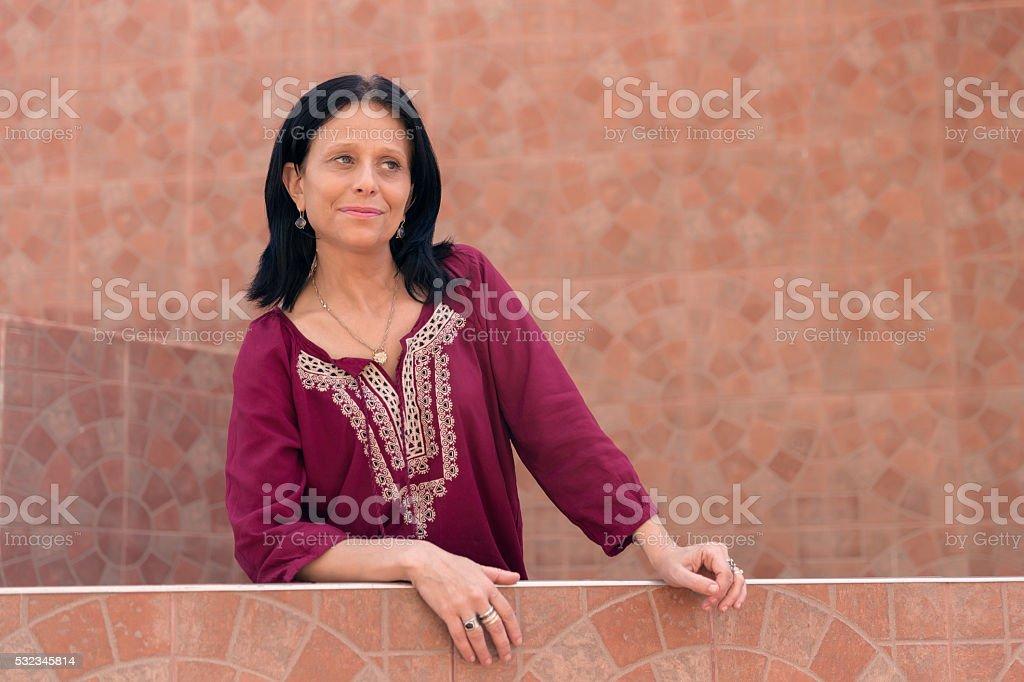 Mature brunette woman in ethnic dress stock photo