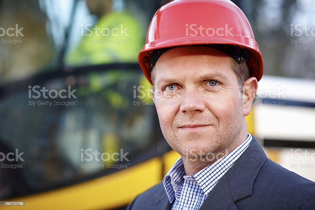 Mature builder wearing hardhat at construction site royalty-free stock photo