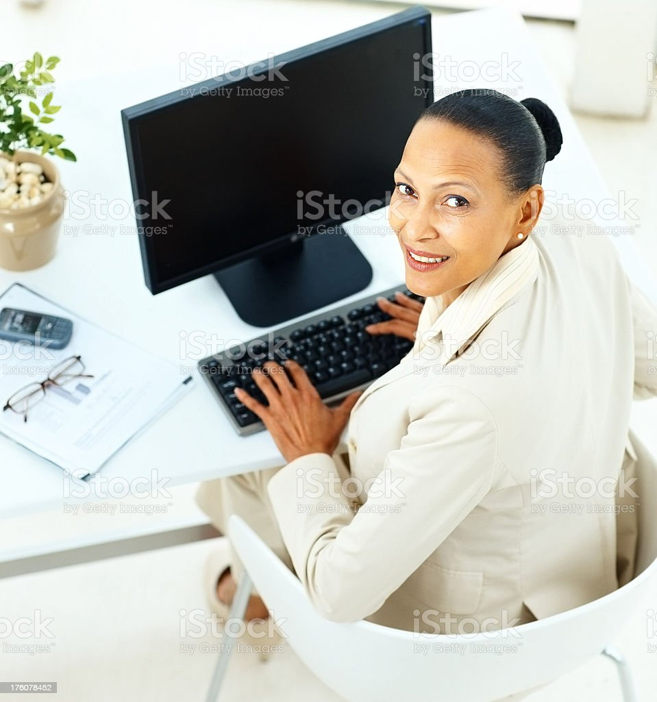 Mature busines woman working on a computer royalty-free stock photo