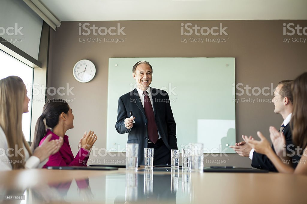 Mature business executive speaking in a meeting royalty-free stock photo