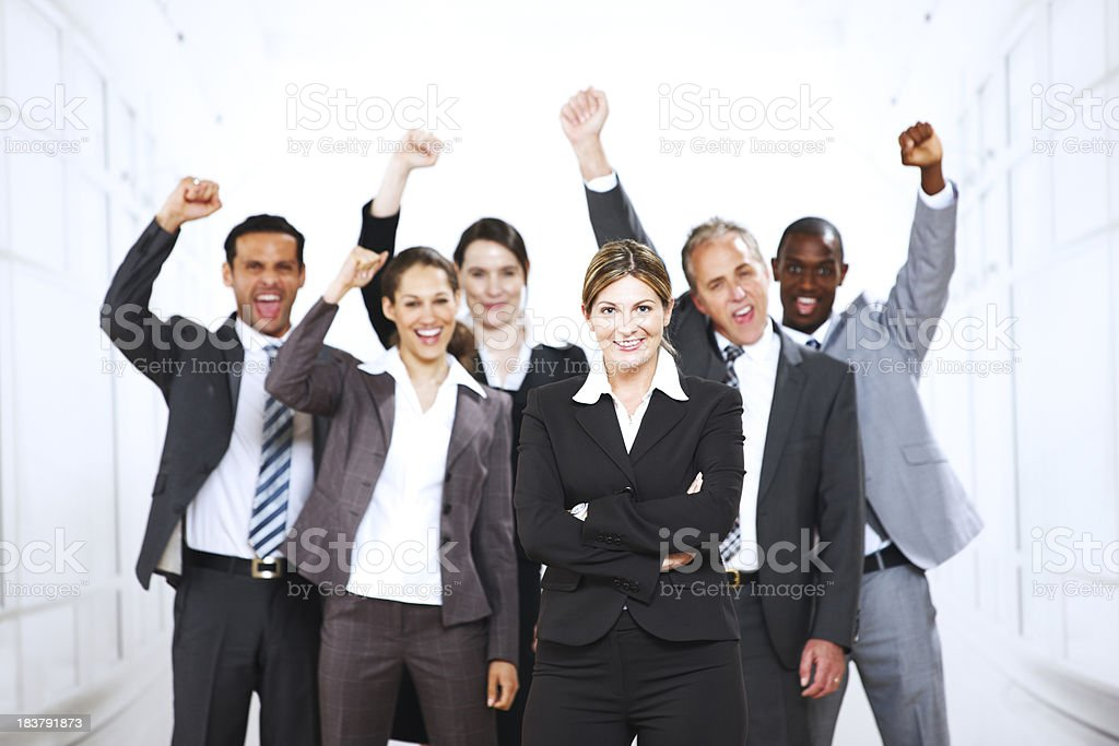 Mature business group cheering at their success royalty-free stock photo