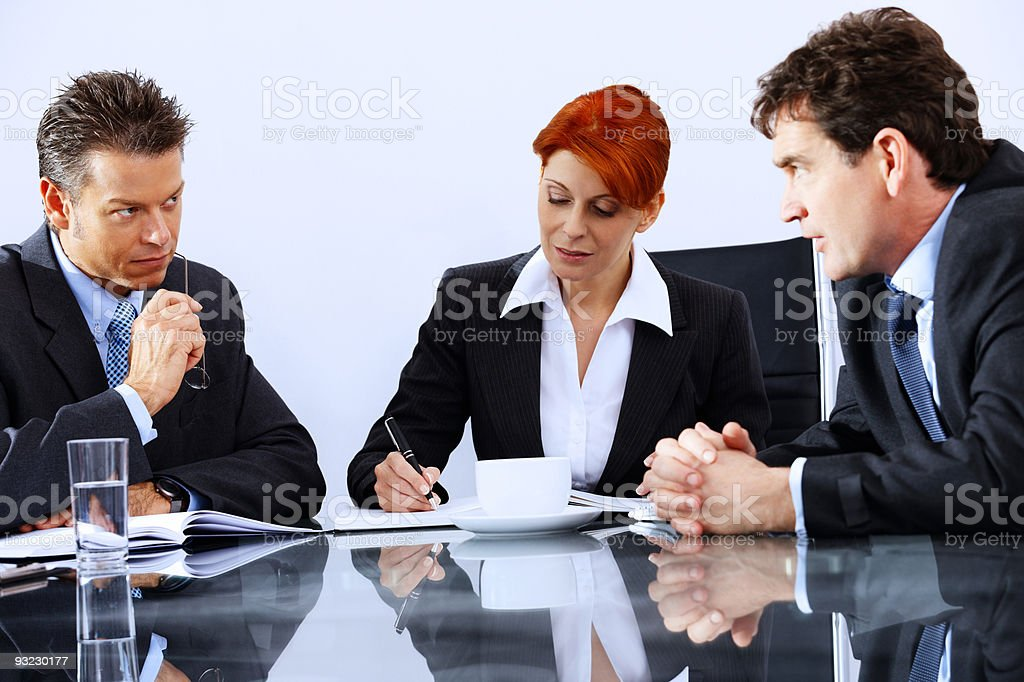 Mature business group discussing reports in modern office royalty-free stock photo