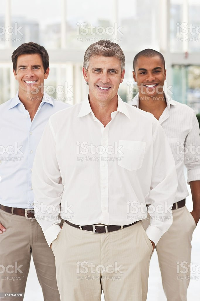 Mature business man and his colleagues royalty-free stock photo