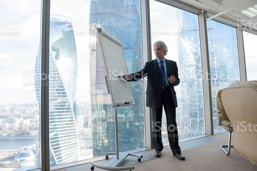 Mature business man making a presentation stock photo