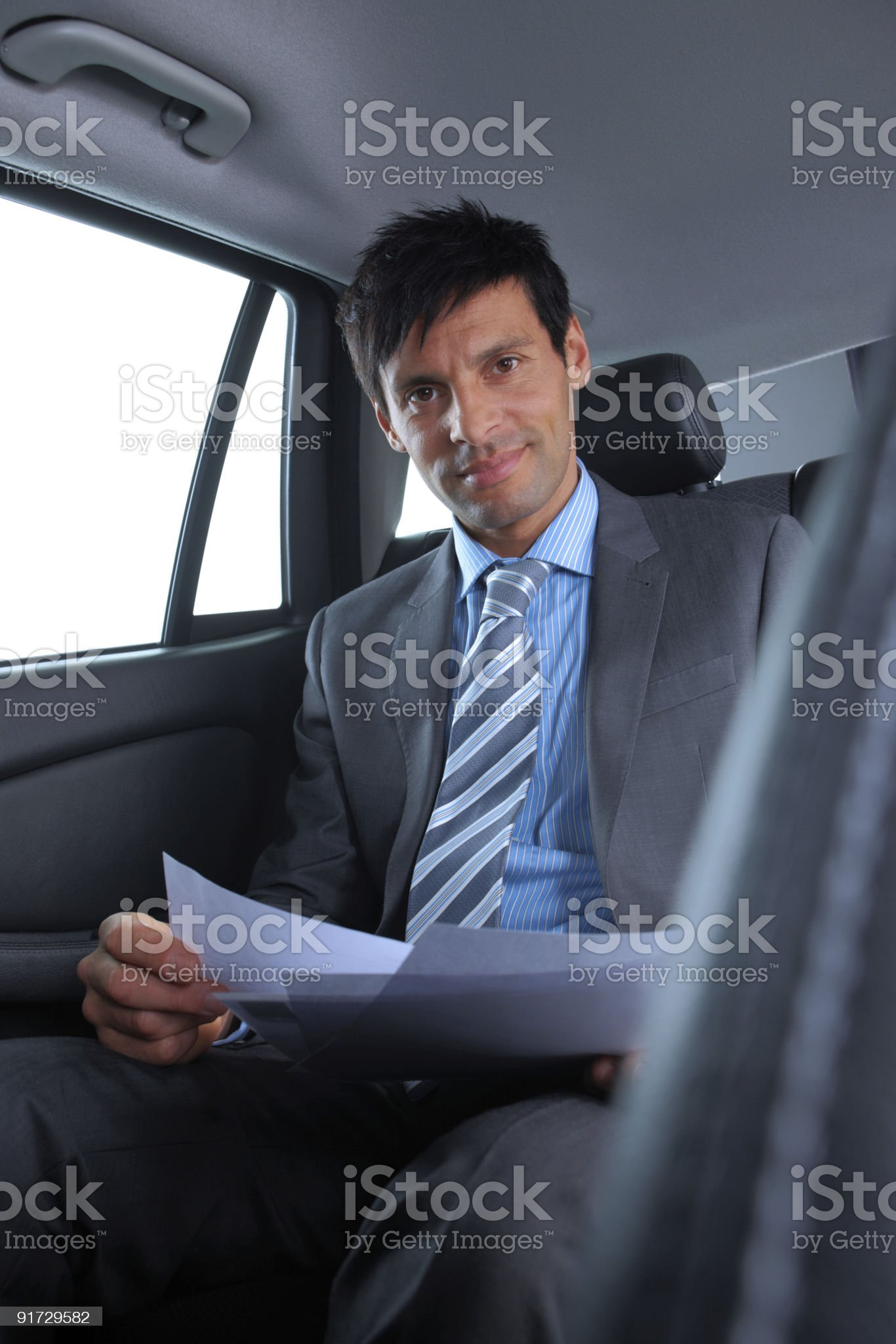 mature Business man reading reports in the back of car royalty-free stock photo