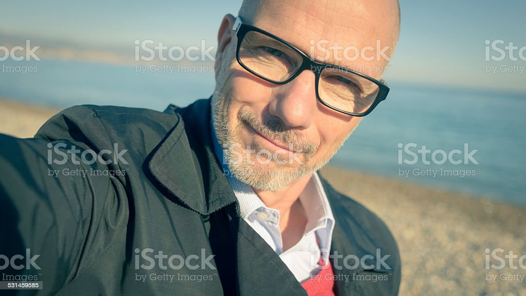 Mature Business Man Selfie at Beach stock photo